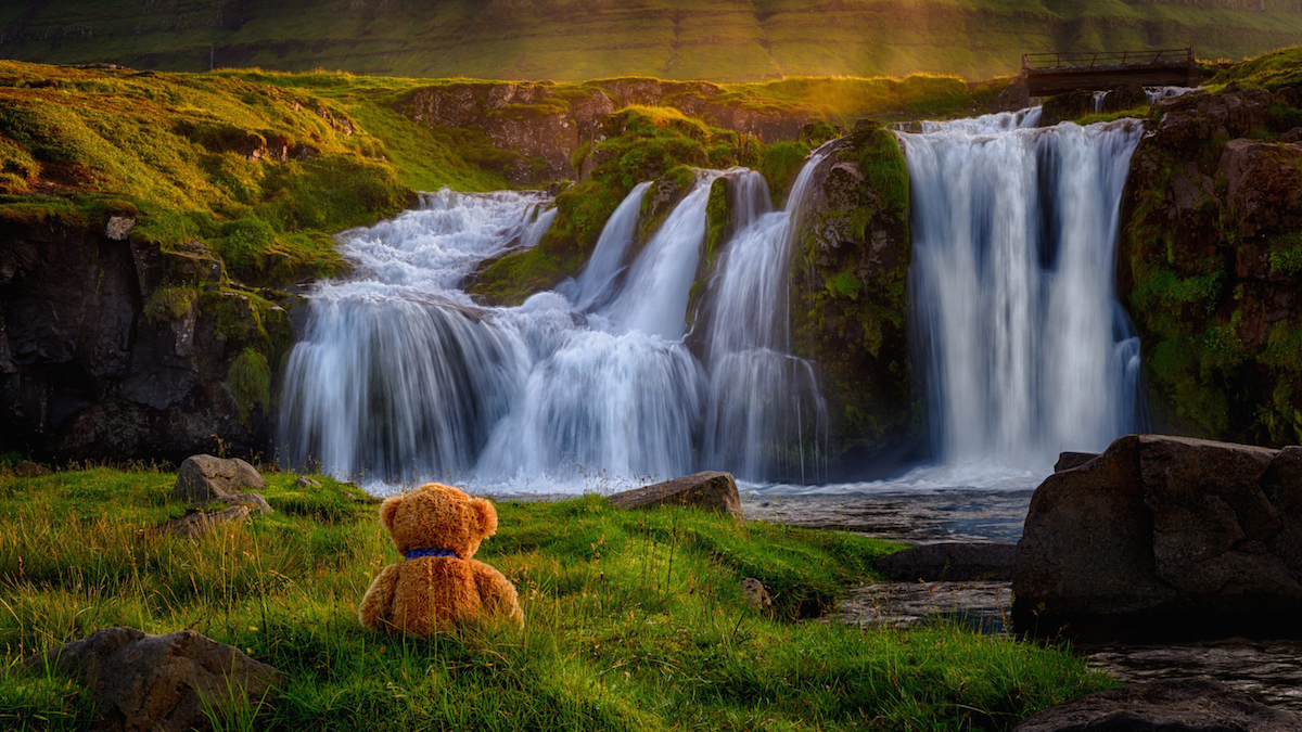 SWNS Pictures of the Year 2015 - One hundred of the most compelling images on the SWNS wire this year as chosen by our picture editors. Pictured - Teddy bear pictured at Kirkjufellsfoss waterfall, Iceland. See Masons copy MNTEDDY. An amateur photographer has taken a string of stunning pictures of his teddy bear on holiday - after his wife refused to pose for the camera. Christian Kneidinger, 51, has captured the cuddly toy in exotic locations including Dubai and Mauritius. The father-of-two decided to put together an album last summer after he and his wife Ranati, 51, went on holiday to Iceland. Christian Kneidinger / Ross Parry