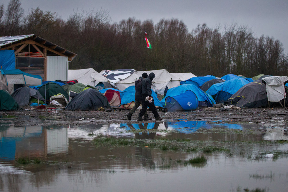 Awful muddy conditions can be seen at the Grand-Synthe migrant camp which holds about 3,000 migrants in Dunkirk, France. 04 January 2016.