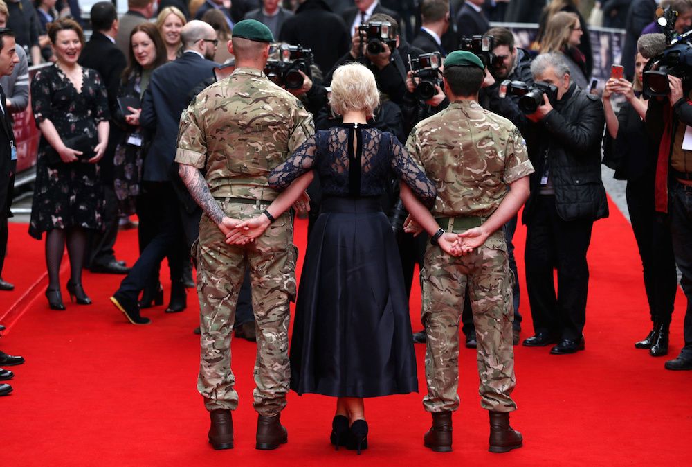 Helen Mirren(centre) is photographed as she attends the premiere of Eye in the Sky at the Curzon Mayfair cinema in London. In the film Helen Mirren plays London-based military intelligence officer Colonel Katherine Powell who is remotely commanding a top secret drone operation to capture a group of dangerous terrorists from their safe-house in Nairobi, Kenya. April 11 2016.