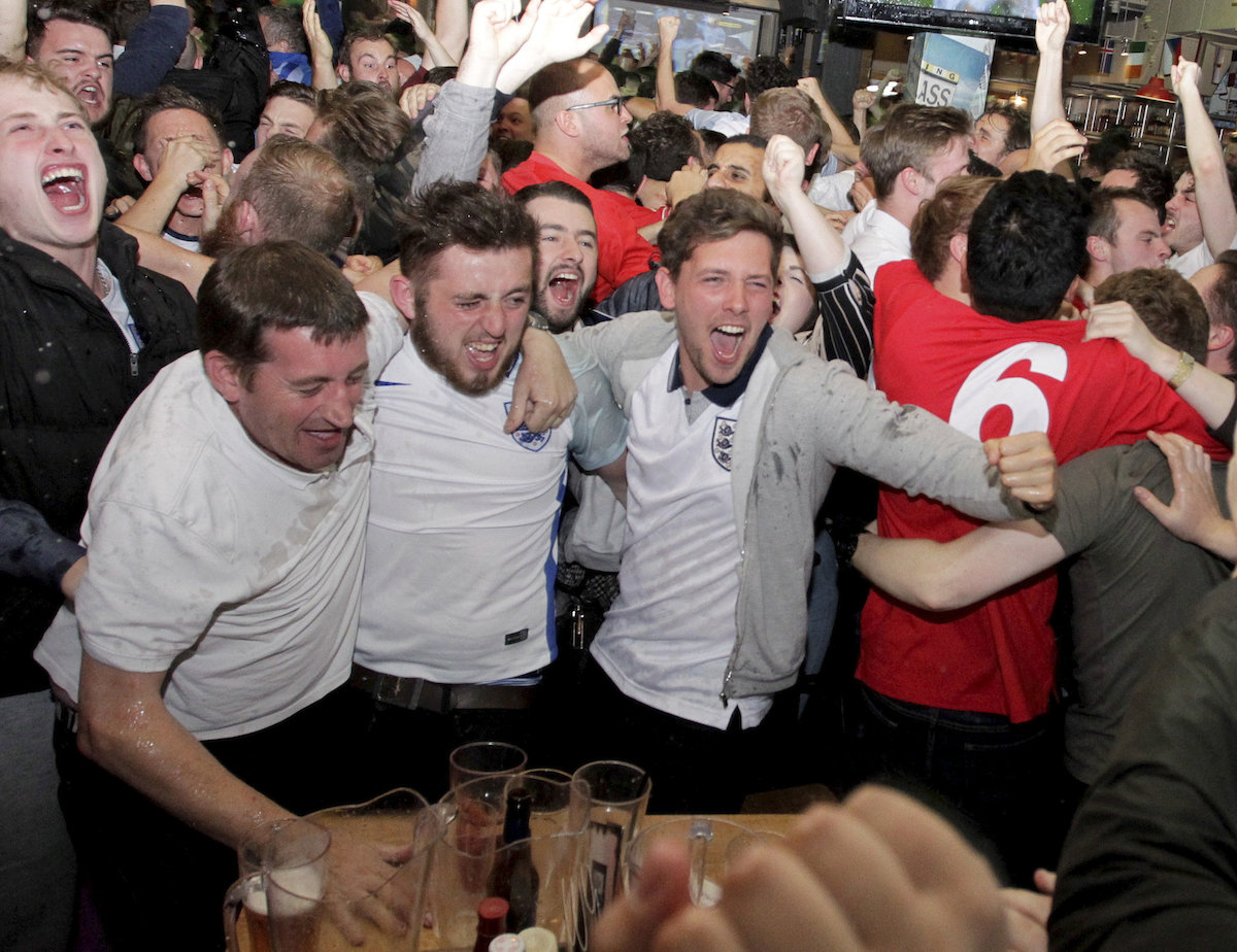 England fans celebrate the winner during the England v Wales match at the Walkabout bar in Birmingham, UK, this afternoon, June 16, 2016.  The teams are meeting in the Euro 2016 Group B clash in Lens.  Roy Hodgson's side were held in their opening clash against Russia, while Wales went into the match full of confidence after their 2-1 win over Slovakia, knowing that a win will put them through to the last-16.