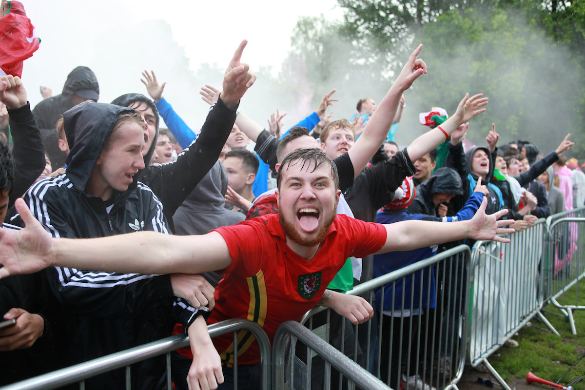 Welsh fans celebrate the opening goal of the game during the England v Wales match at the Fanzone in Cardiff, this afternoon, June 16, 2016.  The teams are meeting in the Euro 2016 Group B clash in Lens.  Roy Hodgson's side were held in their opening clash against Russia, while Wales went into the match full of confidence after their 2-1 win over Slovakia, knowing that a win will put them through to the last-16.